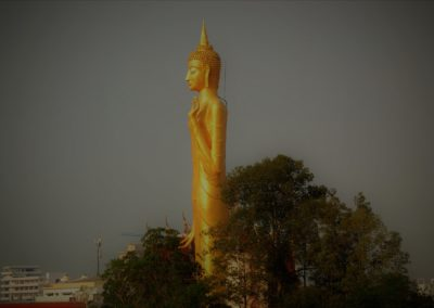 Tall slender Buddha statue in Roi Et Thailand, can be seen at a distance from  many angles